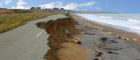 shore erosion destroys a road